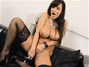 Lisa Ann shoves her fake penis deep in her humid pussy