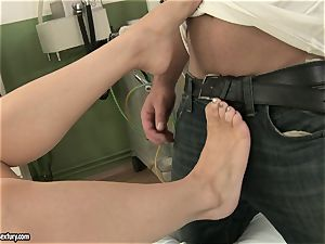Michelle moist fumbling a rigid man meat with her feet